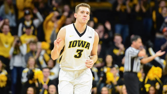 Feb 25, 2018; Iowa City, IA, USA; Iowa Hawkeyes guard Jordan Bohannon (3) reacts after hitting a three point shot during the first half against the Northwestern Wildcats at Carver-Hawkeye Arena. Mandatory Credit: Jeffrey Becker-USA TODAY Sports