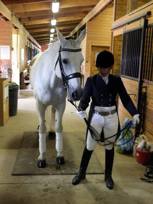 Dominique Cassavetis, 23, a High Bridge resident and champion equestrian who has been pursuing her olympic dream in the area of dressage since she was 13, works with her horse Charming Princess, at Silver Bit & Spur Farm on Friday June 24, 2016