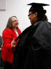 Carolyn Stanley, left, one of the HiSET teachers from Workforce Essentials talks with one of her students Rutherford County jail inmate Devlyn Malone Jones before she received a diploma after passing the HiSET exam and earning a high school equivalency diploma in a graduation ceremony on Nov. 30, 2017, at the Rutherford County Adult Detention Center.