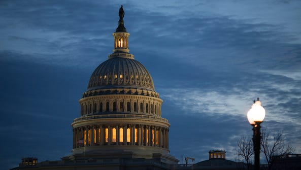 The lamp remains illuminated in the top of the Capitol