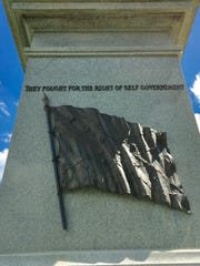 On the side of the monument are the Confederate flag
