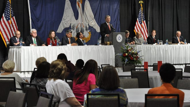 Louisiana Treasurer John Kennedy and other candidates for U.S. Senate speak to participants in the Louisiana Municipal Association Convention during a forum in Alexandria Thursday.