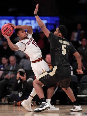 Arizona State guard Shannon Evans II (11) looks to pass against Purdue forward Basil Smotherman (5) in the first half of an NCAA college basketball game, Tuesday, Dec. 6, 2016, in New York.