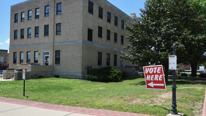 A 'Vote here' sign points the way to the Baxter County Courthouse. Early voting in Baxter County continues through May 21 at the courthouse.