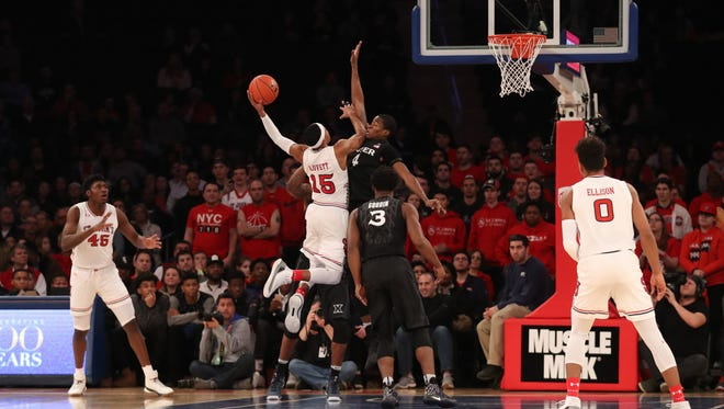 St. John's Red Storm guard Marcus LoVett (15) is stopped by Xavier Musketeers guard Edmond Sumner (4) during the first half at Madison Square Garden on Jan. 29.