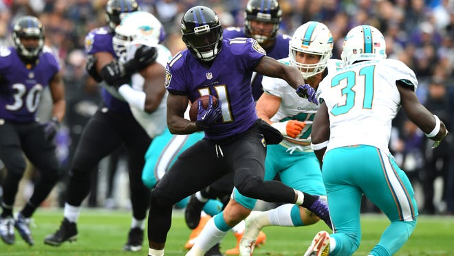 Dec 4, 2016; Baltimore, MD, USA;  Baltimore Ravens wide receiver Kamar Aiken (11) runs after the catch as Miami Dolphins free safety Michael Thomas (31) and middle linebacker Kiko Alonso (47) defends during the first quarter at M&T Bank Stadium. Mandatory Credit: Tommy Gilligan-USA TODAY Sports
