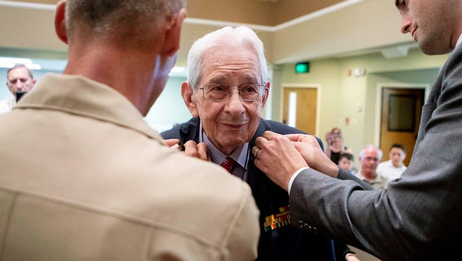 Cpl. Edgar Harrell receives his pins during his honorary promotion to the rank of sergeant in front of loved ones at his family's church, Calvary Bible Church, on Thursday, August 9, 2018, in Joelton, Tenn. Harrell enlisted in 1943 to the U.S. Marine Corps and is the only living Marine survivor from the USS Indianapolis sinking in 1945.