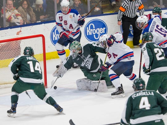 Diving to make a stop Saturday is MSU senior goalie Ed Minney (45), who formerly played for the U.S. National Team Development Program.