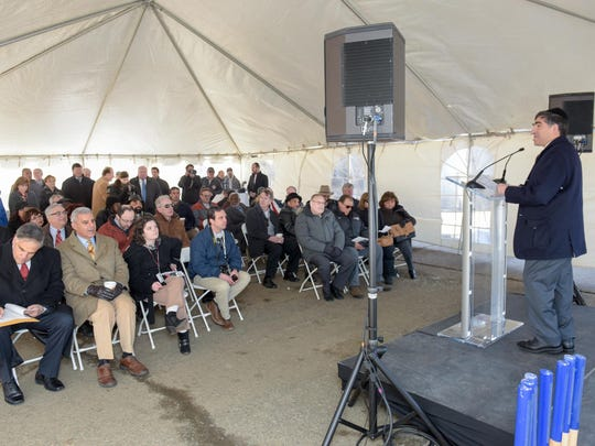 Ralph Zucker, president of Somerset Development Corp., speaks at the podium about redevelopment plans for the old Anchor Glass factory in Aberdeen.