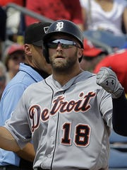 Detroit's Tyler Collins reacts after hitting an RBI triple off Philadelphia's Andrew Bailey on Saturday.