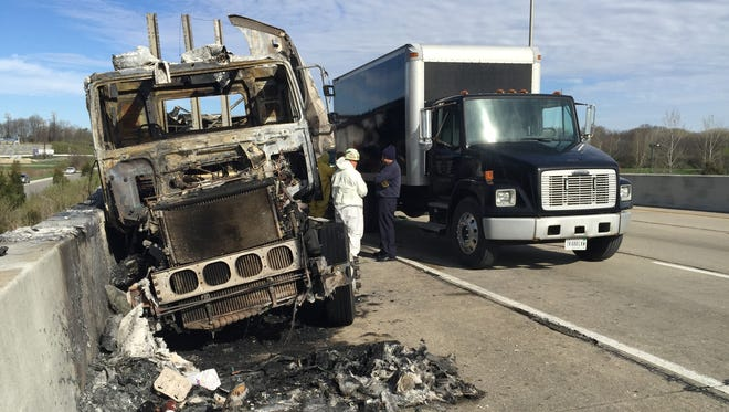 Firefighters and Hazmat crews battled a fire after a semi crashed on I-65 on the Westside Wednesday morning.