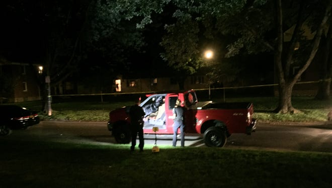 Rochester police technicians investigate a red pickup truck in front of a shooting scene at 20 Ramona Park in Rochester on Aug. 13, 2015.