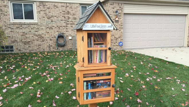 A Little Free Library at Karl and Susan Koss' home in Clinton Township. It was installed in September 2014.