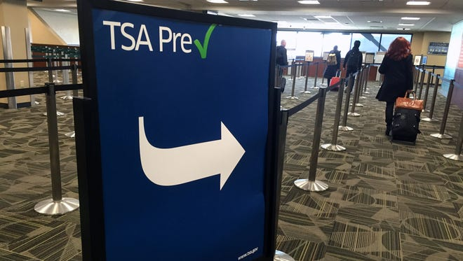Travelers walk into the screening area of Reno-Tahoe International Airport. Transportation Security Administration officials are set to offer Pre-Check enrollment for Reno holiday travelers.
