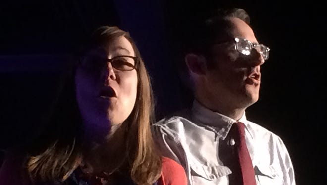 """Natalie Miller and Nathan Hartswick walk off stage singing """"America, the Beautiful"""" Thursday as The Unmentionables performed """"Trumprov!"""" at the Vermont Comedy Club."""