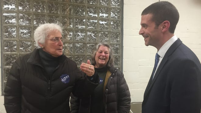 Ben Lindy, right, talks with supporters after the Hamilton County Democratic Party executive committee meeting on Feb. 4 in Northside.