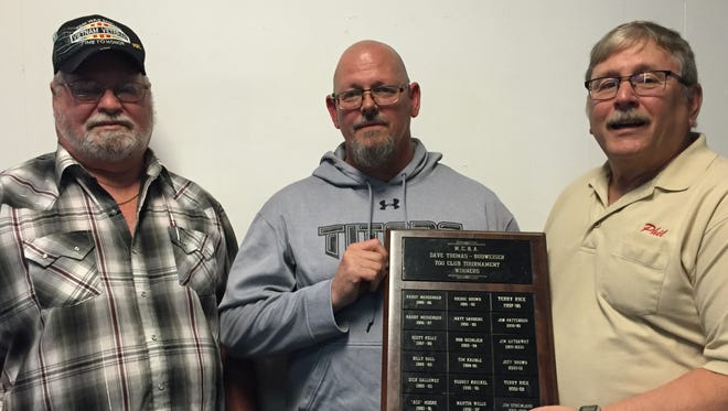 American Legion Post 584 Commander Cladis Whitaker, left, and Marion USBCBA President Phil Shroyer, right, show winning bowler Rick Pryor the Marion USBCBA Dave Thomas American Legion Post 584 700 Club Tournament plaque.