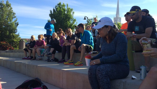 Triathletes from around Utah gather at Town Square in St. George to listen to a clinic about sports psychology Sunday, April 24, 2016.