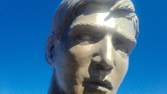 The face was changed so that it would not resemble model Rocky Dodson. The sculptor did not want the face to look like the well known local basketball coach.