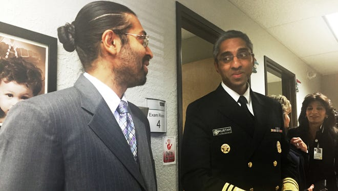 U.S. Surgeon General Vivek Murthy, right, tours a University of New Mexico treatment center that helps people recover from addiction to opioids, in Albuquerque Tuesday, June 14, 2016. Murthy is conducting a multi-state tour focused on the nation's opiate epidemic.