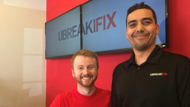 Justin Murphy, left, and Jeremy Azinger are business partners at the new uBreakiFix location in downtown Fort Myers.