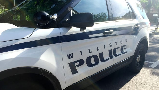 A Williston Police vehicle is parked in downtown Burlington on Friday, July 1, 2016.