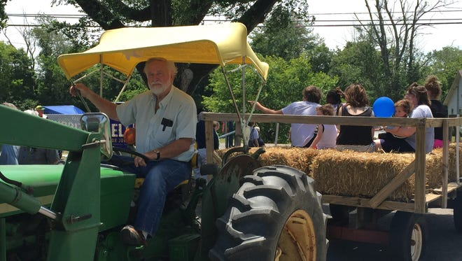 Bob Jones drives children and adults around Rockvale during the community's annual Fourth of July picnic on Monday morning.