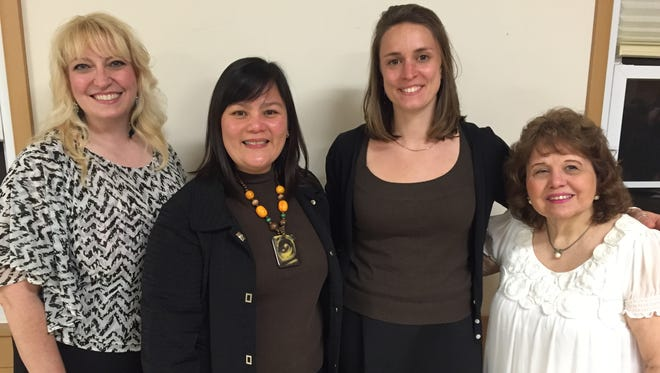 Pilar Garcia-Villacorte, second from left, of Princeton and Perrine Panis, second from right, of Princeton were recently welcomed to the Jersey Harmony Chorus of Sweet Adelines International by chorus director Kat Britt, far left, and membership chairwoman, Carole Auletta, far right.