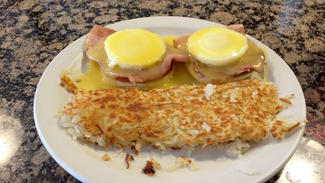 The Eggs Benedict at the Main Street Grill in Cedar City is served with a large side of hashbrowns.