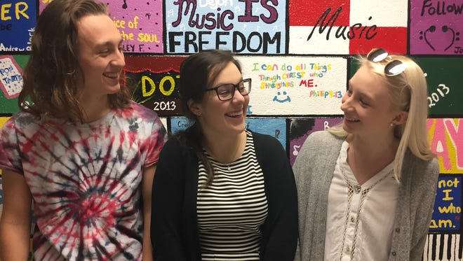"""Theater students Ben Josefson, Julia Bussey and Abby Ludwig talk about what fun they had rehearsing this year for the spring musical. Josefson is Drew, Bussey is Lonny and Ludwig is Sherrie in """"Rock of Ages,"""" on stage March 9-12 at Stuarts Draft High School."""