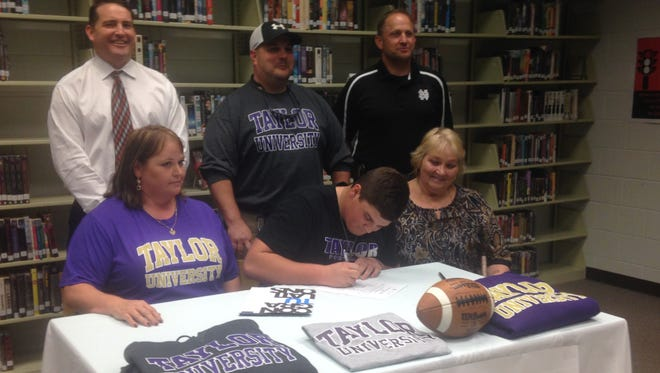 North Buncombe senior Austin Ponder has signed to play college football for Indiana's Taylor University.
