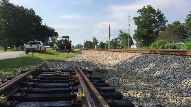 Workers at work on CSX's railroad track on July 10, 2017 in Cantonment. The workers will add new switches to the track.