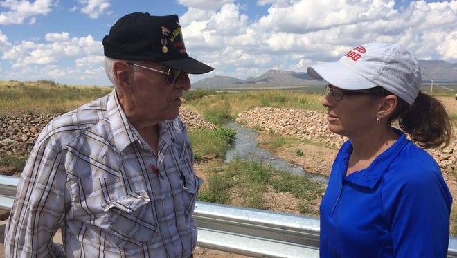 Longtime Naco, Arizona, resident Gerald Everwein explains to U.S. Rep. Martha McSally about the spill of wastewater from Mexico into his property, located just across the border, on Sept. 18, 2017.