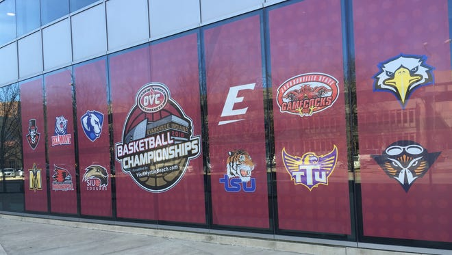 The Ford Center's first-floor window has decals of Ohio Valley Conference schools. The OVC men's and women's basketball tournament starts Wednesday.