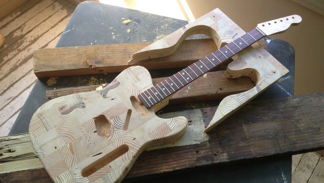 Mark Wallace looks for salvageable lumber amongst Detroit blight and turns it into guitars.