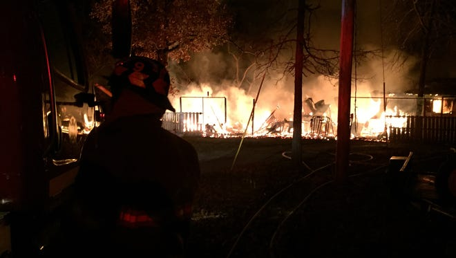 Firefighters battle a blaze at home Gladehill Lane, located off County Road 54 south of Mountain Home.