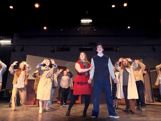 """Audrey (Julia Rosenquist), Seymour (Dylan Hoppel) and cast sing """"Downtown (On Skid Row)"""" during the opening act of Kettle Moraine Perform's production of """"Little Shop of Horrors."""""""