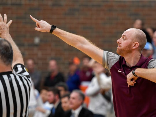 Webster County head coach Jon Newton signals his team with 1.4 on the clock as the Union County Braves play the Webster County Trojans in the Sixth District Tournament at Colonel Gym in Henderson Tuesday, February 20, 2018.