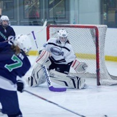 Goalie Maddie Marciw, shown making a save for the Suburban
