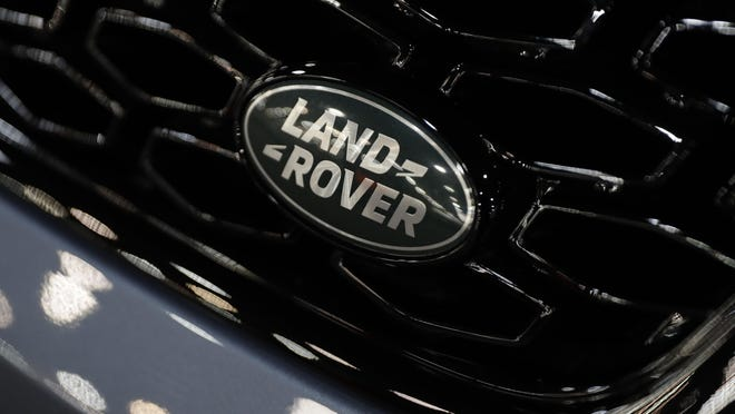 Sales of Jaguar sports cars and Land Rover SUVs dropped 35 percent in the world's biggest auto market in the nine months to Dec. 31.