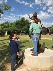 Sculptor Vic Payne puts a few finishing touches on