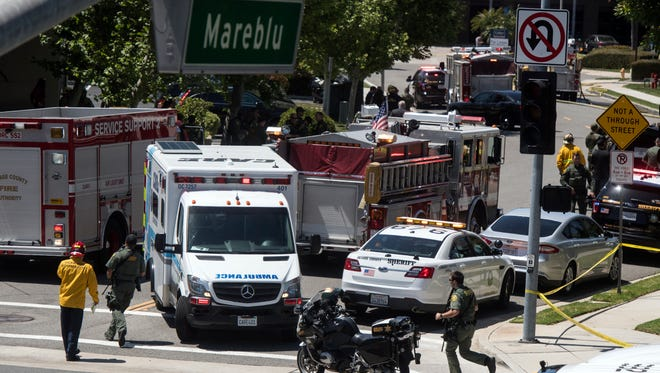 First responders investigate the scene of an office explosion in Aliso Viejo, Calif.