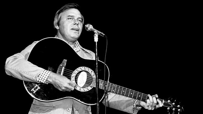 Tom T. Hall performs for his fans during the RCA Records lunch and show at the Grand Ole Opry House on Oct. 13, 1977, part of the DJ convention.