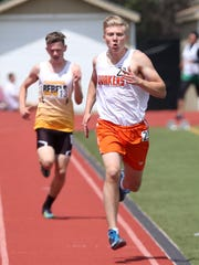 Horace Greeley's Kristofer Arboleda wins the the boy's 1500  during the  Somers Lions Club Joe Wynne track and field invitational at Somers High School May 5, 2018.