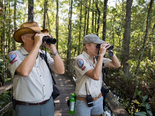 Keith Johnson and Amy Swanson, both boardwalk naturalists,