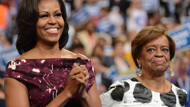 First Lady Michelle Obama and her mother Marian Robinson clap to a speech at the Time Warner Cable Arena in Charlotte, North Carolina, on September 6, 2012 on the final day of the Democratic National Convention (DNC). (Robyn Beck/AFP/Getty Images)