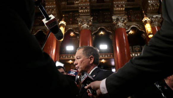 John Kasich speaks to the media after the Republican