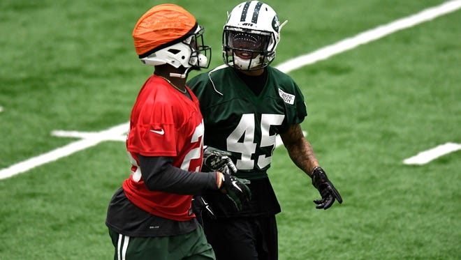 New York Jets safeties Marcus Maye, left, and Rontez Miles talk during their organized team activities at the Atlantic Health Jets Training Center in Florham Park, NJ on Tuesday, June 6, 2017.