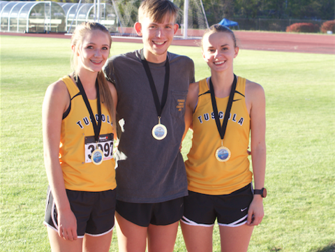 Tuscola runners Jacob Franklin, Brooke Turner and Lydia Cagle.