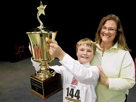 RUBEN R RAMIREZ—EL PASO TIMES Liam Nyikos representing Riverside Elementary of Carlsbad, New Mexico is the winner of the 2015 El Paso Times Spelling Bee. Here Nyikos poses with mother Melinda Nyikos shortly winning the bee.